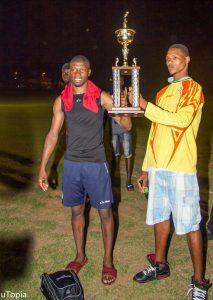 Dublanc FC goal keepers lifting championship trophy